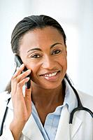 Hispanic female doctor talking on cell phone
