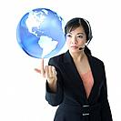 Asian businesswoman with globe on fingertip