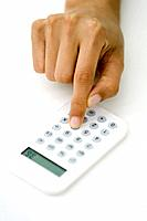 Person using calculator, cropped view of hand (thumbnail)