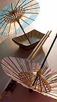 Chopsticks and oriental umbrellas
