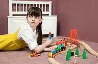 A girl playing with a train set (thumbnail)