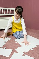 A girl doing a jigsaw