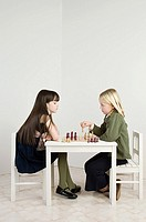 Friends playing chess
