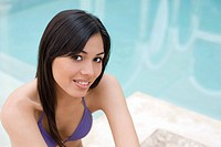 Young woman by pool