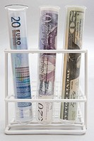 Three banknotes in test tubes