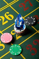 Gambling chips on a roulette table