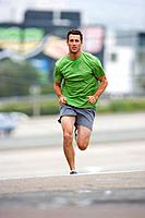 Man running outdoors, portrait