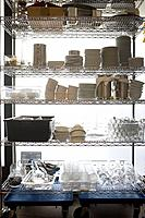 Dishes and containers on kitchen rack