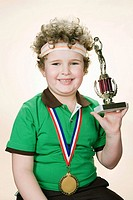 Portrait of a boy holding a trophy (thumbnail)