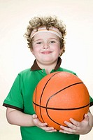Portrait of a boy holding a basketball