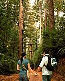 Mixed race couple hiking in woods