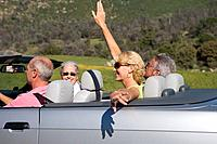 Senior couple with friends in convertible car