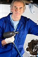 Mechanic with power tool, portrait (thumbnail)