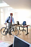 Businessman with bicycle in office