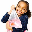 Mixed race girl holding goldfish in a bag