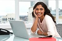 Trinidadian businesswoman smiling with laptop