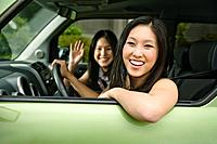Asian teenagers driving in car