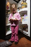 Little girl holding eggs