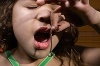 Girl eating a worm