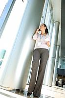 Low angle view of businesswoman talking on cell phone