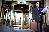Businessman with briefcase outside of hotel