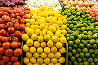 Close up of tomatoes, lemons and limes (thumbnail)