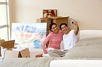 Couple taking self-portrait in new home