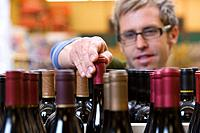 Man choosing a bottle of wine
