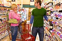 Couple flirting in grocery store