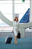 Businesswoman walking through airport terminal