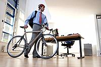 Businessman in helmet with bicycle