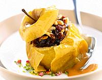 Baked apple stuffed with dried fruits