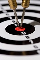 Two Darts in bull´s_eye, close_up