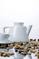Pebbles with teapot and tea cup, close_up
