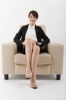 Businesswoman sitting on chair, portrait