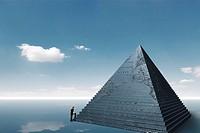 Businessman climbing on pyramid