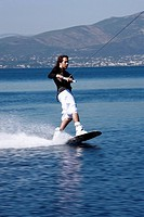 Young adult male waterskiing (thumbnail)