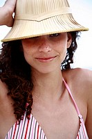 Female young adult wearing sun hat on the beach