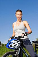 Young woman with mountainbike