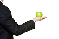 Businessperson holding apple on palm, close_up