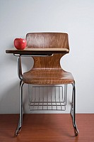 Vacant chair with apple on desk