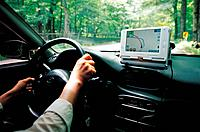 Driver Using Navigation in the Car