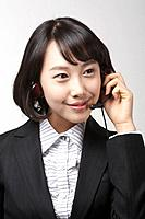 Young Korean Woman with Headset