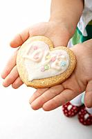 Heart Shaped Cookie on Girl´s Hands