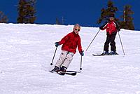 A brother and sister skiing spring snow at Diamond Peak NV