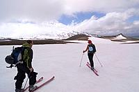 Two skiers climbing Mount Vsevidov in the Aleutian islands