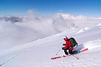 A woman skiing on a glacier on Mount Vsesevidov in the Aleutian Islands in Alaska