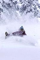 A woman skiing deep powder snow in a storm Alpine Meadows in Lake Tahoe California