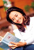Young korean Woman Reading
