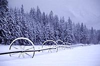 Snow on farm equipment near Winthrop Washington